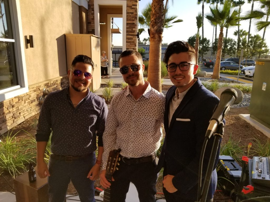 Ian Kauffman with two additional musicians at a corporate event